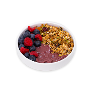 Acai Bowl with berries and granola in a white bowl