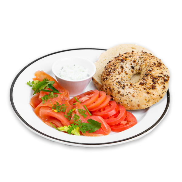 Bagel with tomatoes, smoked salmon, dill, with cream cheese on a white plate