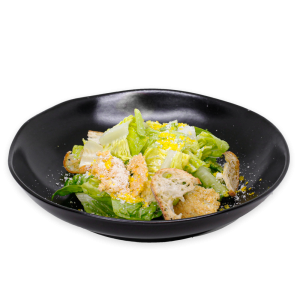 Caesar Salad on a black plate