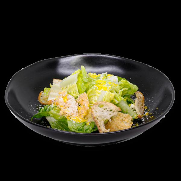 Caesar Salad on a black plate