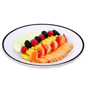 Melon, Oranges, Berries, and Pineapple sliced on a white plate