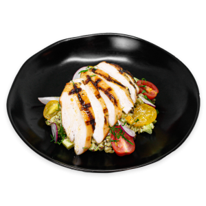 Lemon Pesto with grilled chicken on a black plate
