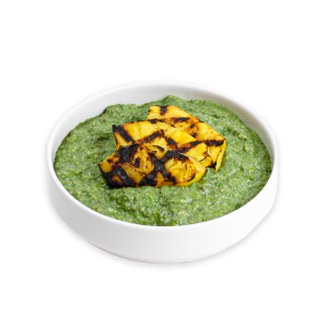 Matcha Chia Pudding with Grilled Pineapple in a white bowl