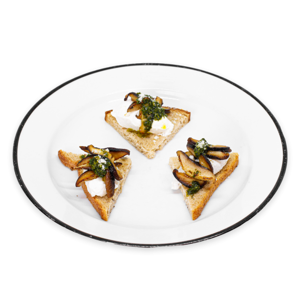Ricotta and Mushroom Tartine on white plate