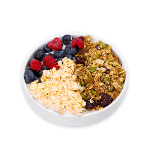 Overnight Oats with Berries and Granola in a white bowl