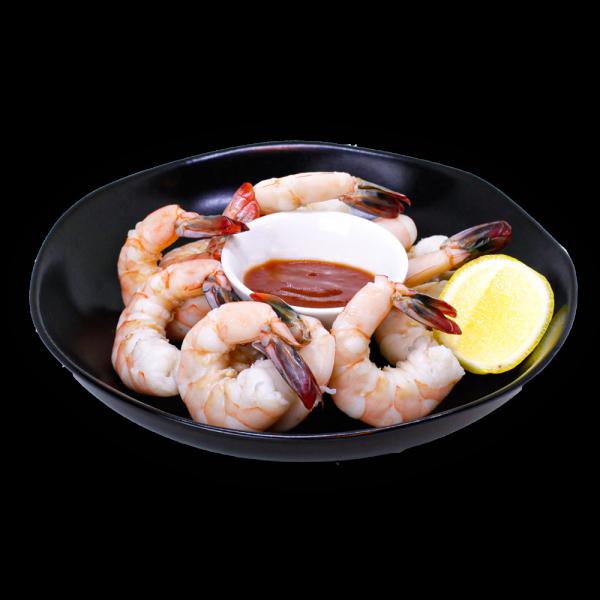 Shrimp Cocktail in a black bowl with lemon